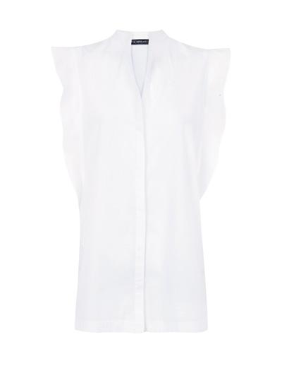 Blusa e imagen de Blanco Suite