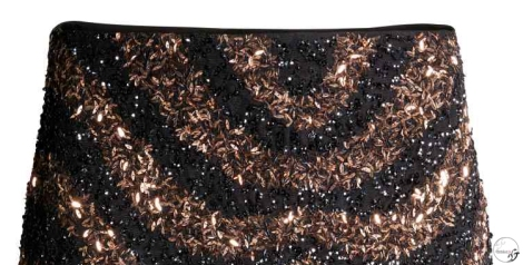 Falda de lentejuelas con tonos dorados de H&M